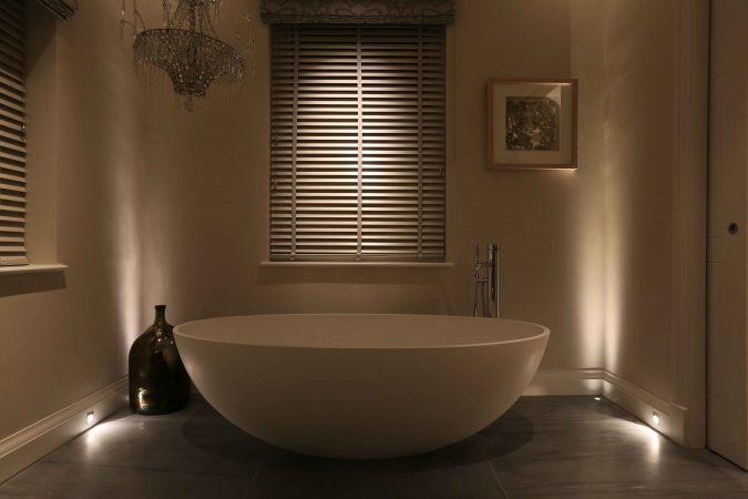 layered bathroom lighting with low level floorwashers