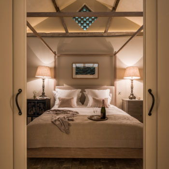 glamorous bedroom with uplit pitched ceiling