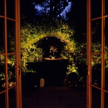 View from conservatory to the rose arch beyond