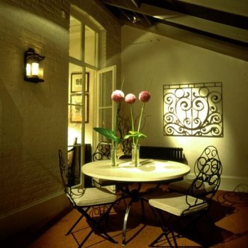 a traditional dining space with lit flowers