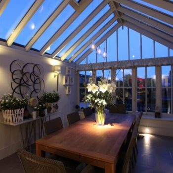 conservatory dining room with light onto the flowers