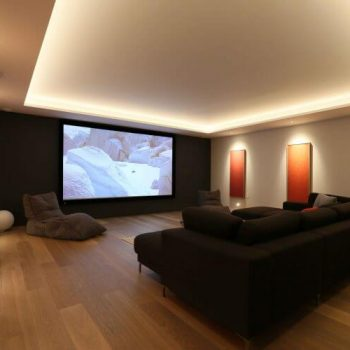 Relaxed cinema room with layered lighting