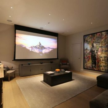 Contemporary screening room with colourful art