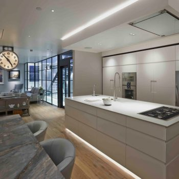 white contemporary kitchen with view to living space beyond