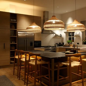 Kitchen island with wicker pendants and downlights