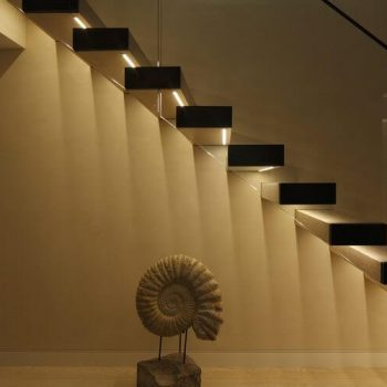 Underside of staircase lit with linear light