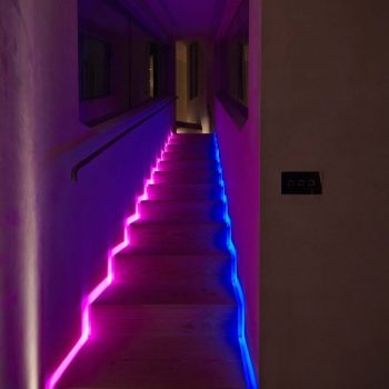 Contemporary staircase uplit with coloured light