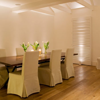 white dining room with candles