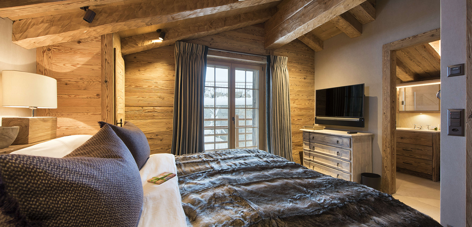 traditional wooden chalet bedroom lighting