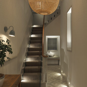 london hallway and staircase with layered lighting