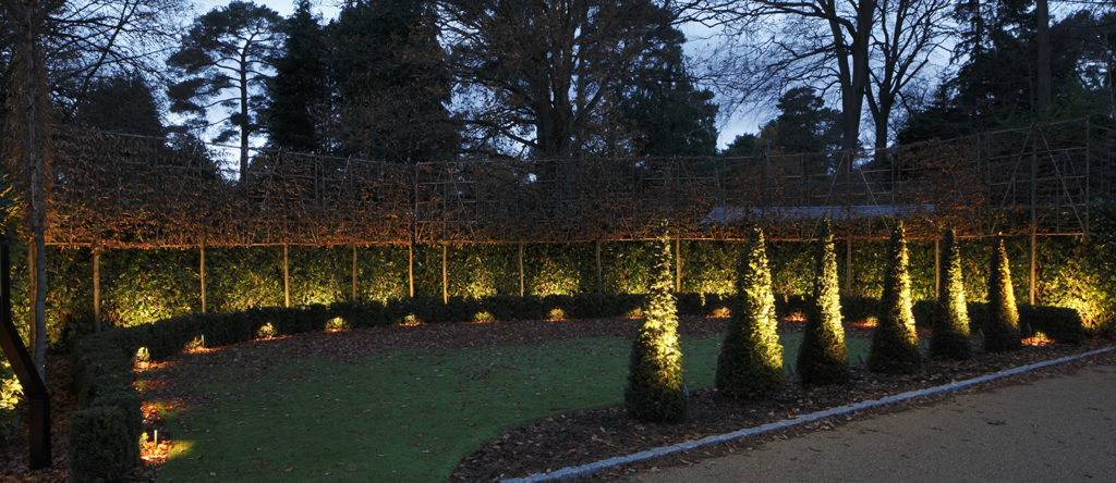 front garden lit with spiked spotlight and floodlights