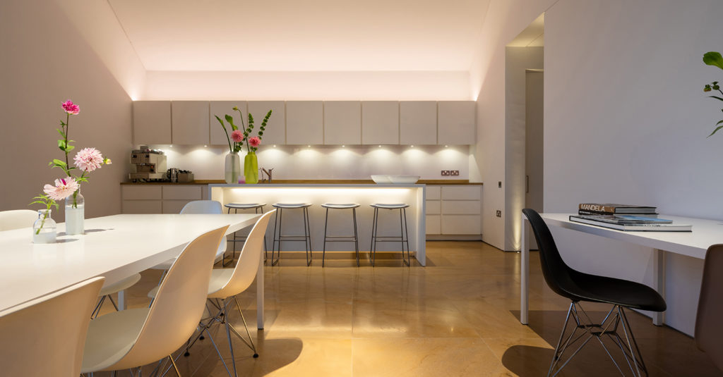 Architectural lighting for double height contemporary kitchen