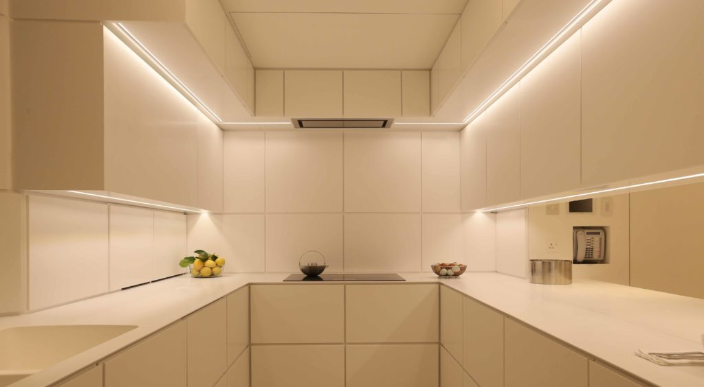 white kitchen with concealed led strip lighting