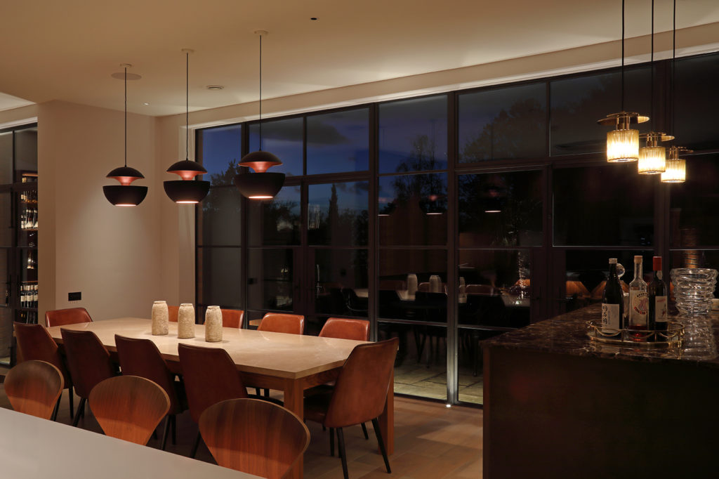 decorative lighting over dining table and bar