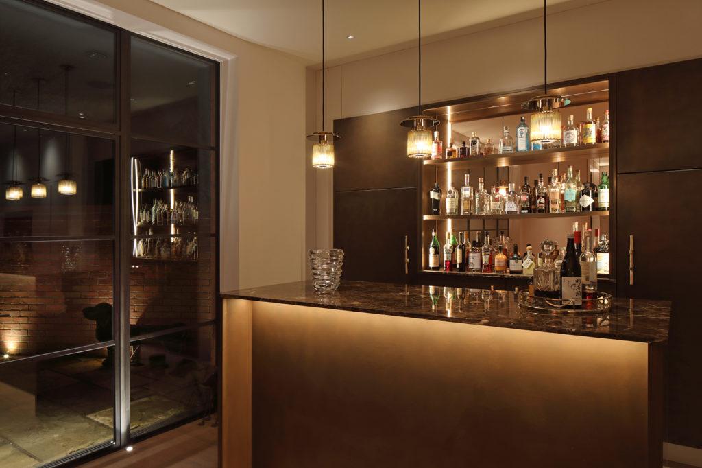 Strip lighting in bar and uplighting to windows