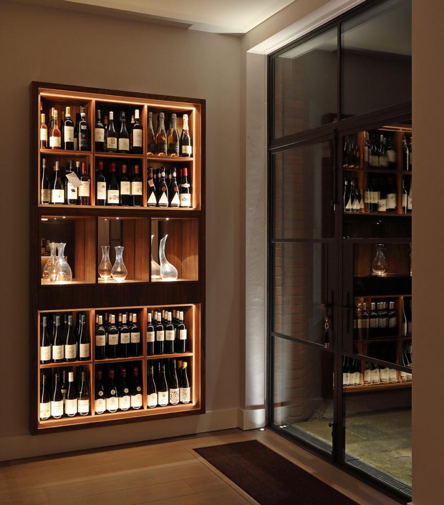softly lit walnut wine racks