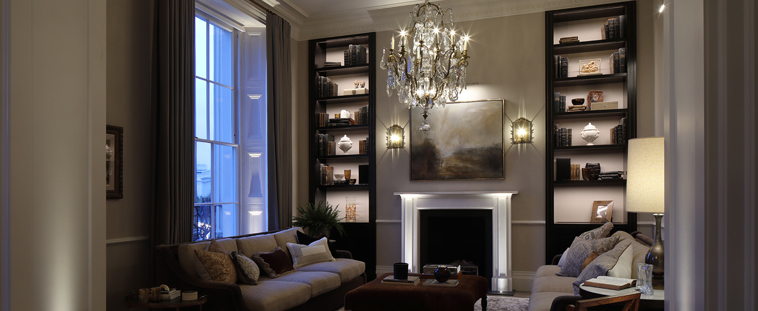elegant living room with high ceilings and shelving