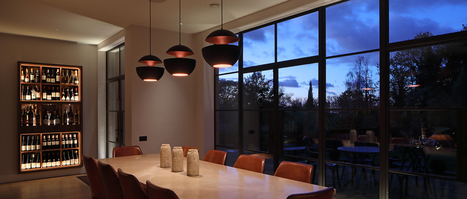 Elegant dining room lighting with view, pendants and wine rack