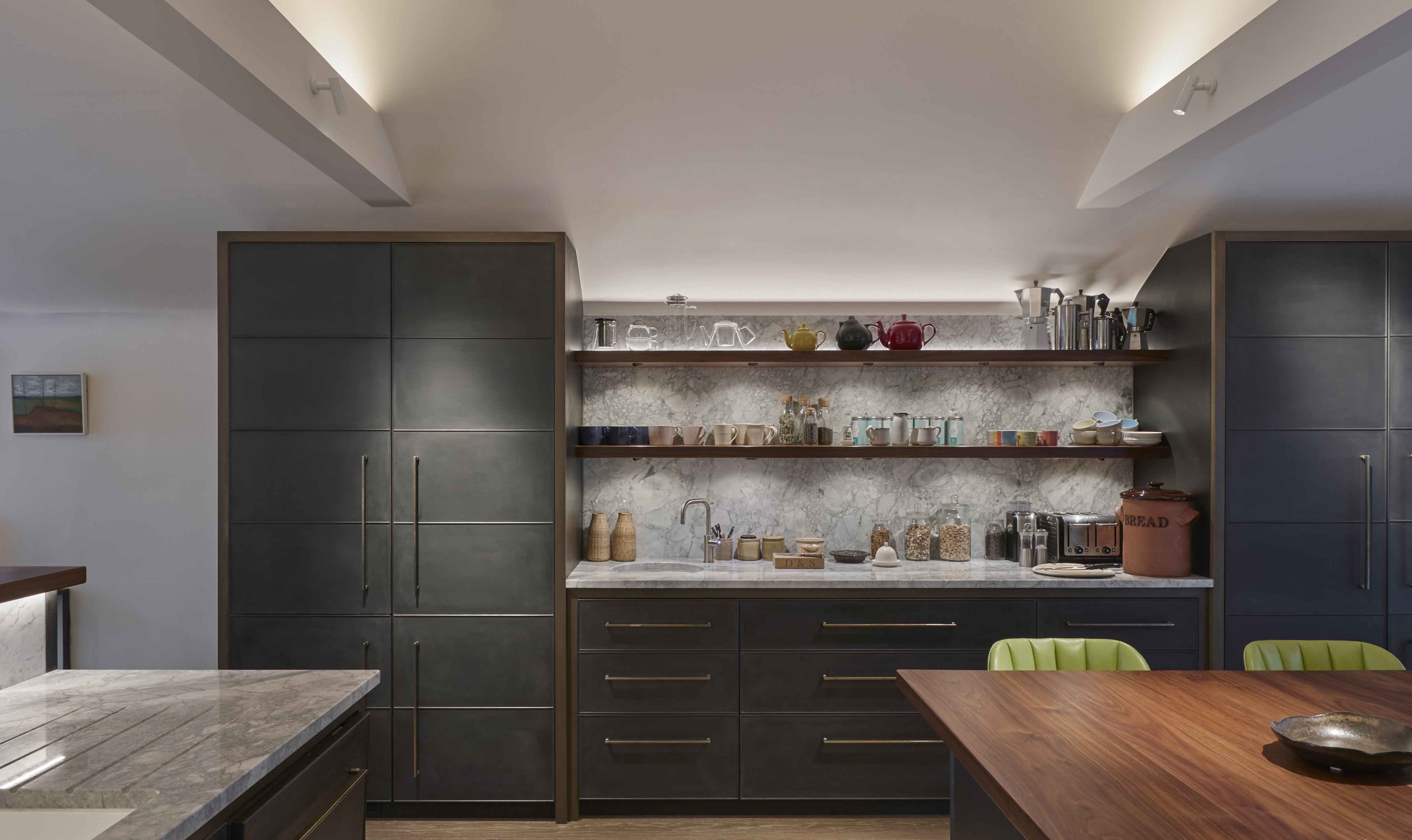 softly lit kitchen cabinets and open shelving