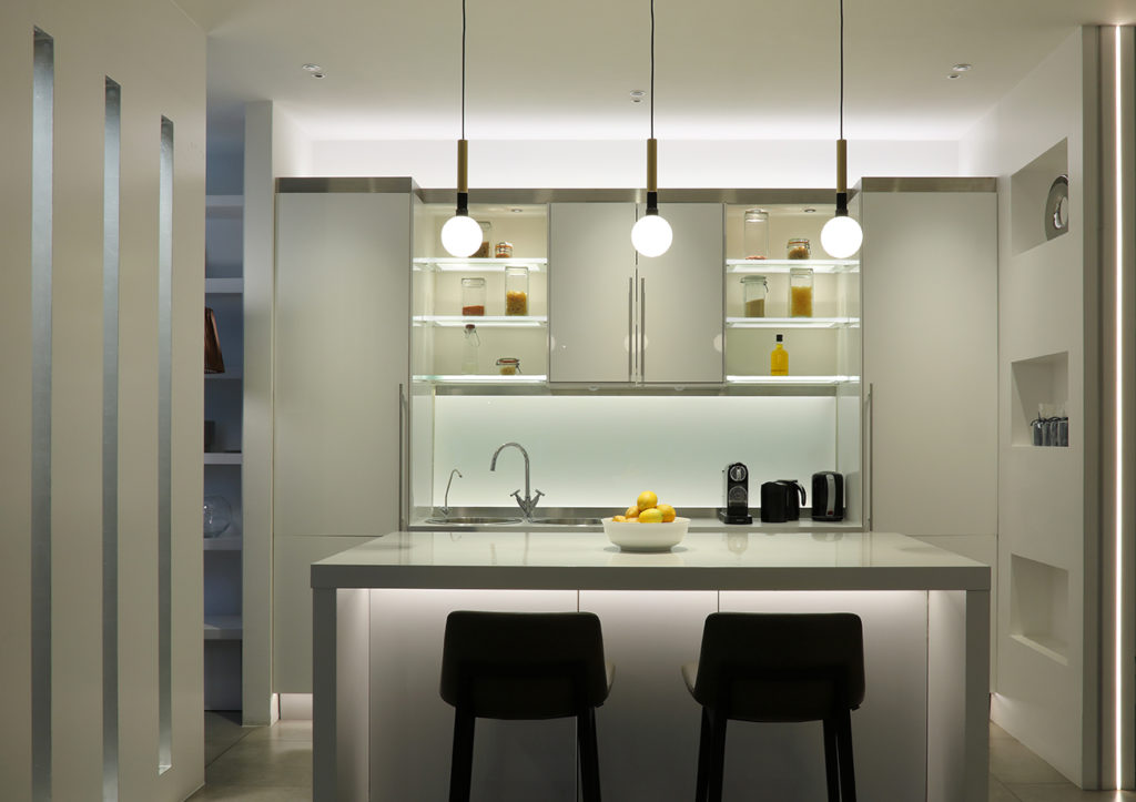 linear lighting integrated into contemporarykitchen