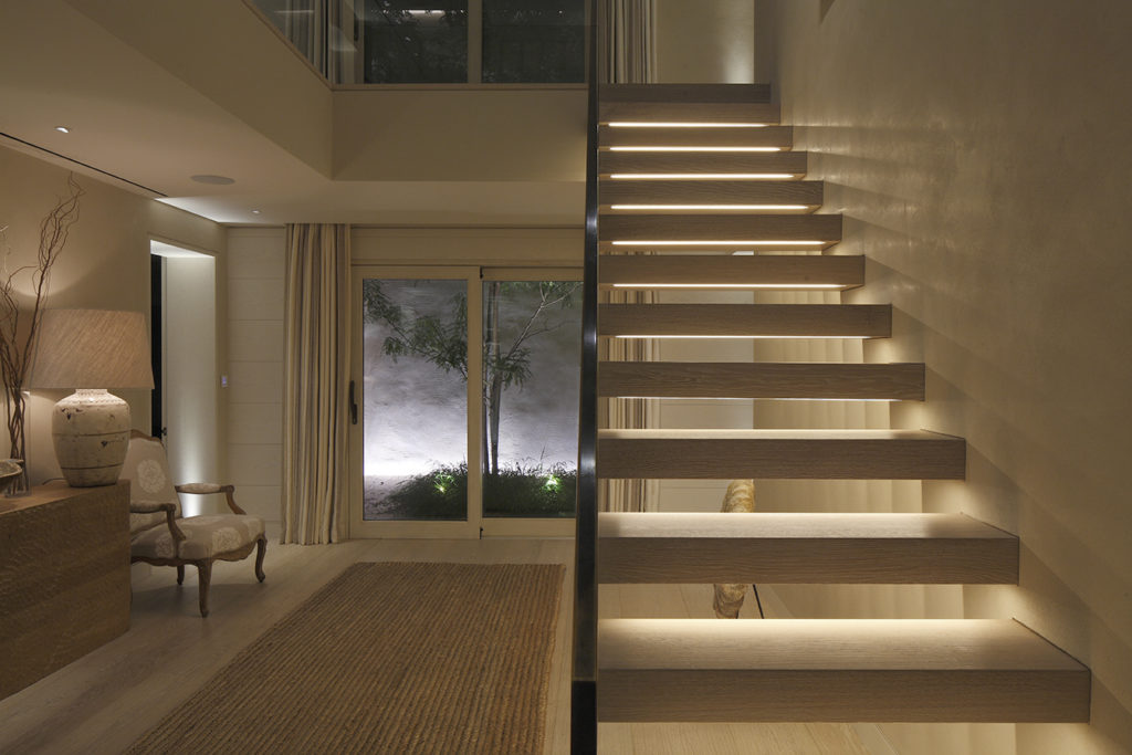 integrated linear lighting into contemporary staircase