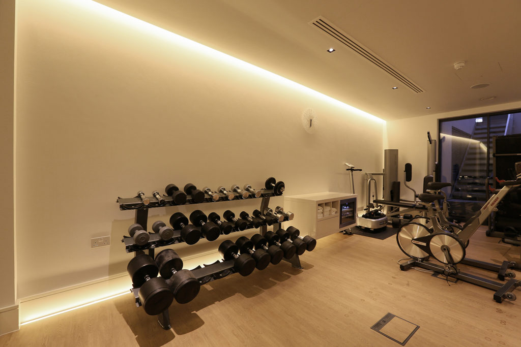 gym with integrated linear lighting in slot