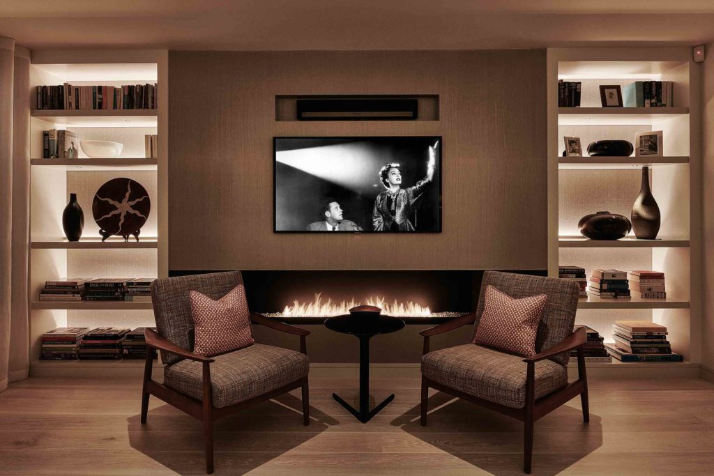 back lit shelving with TV screen