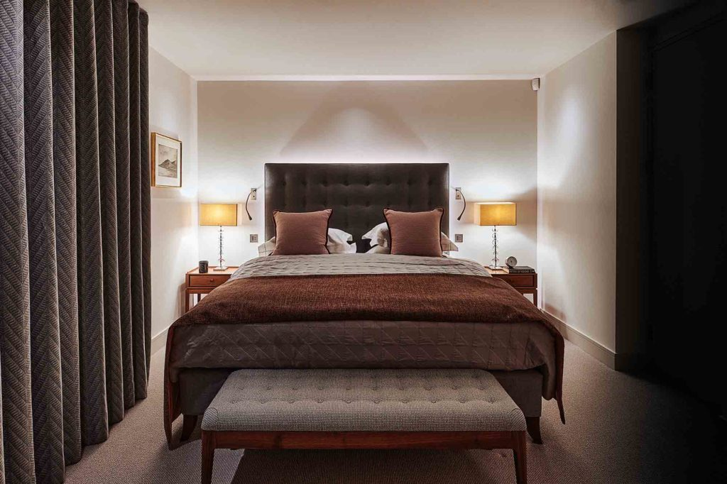 master bedroom with back lit bedhead