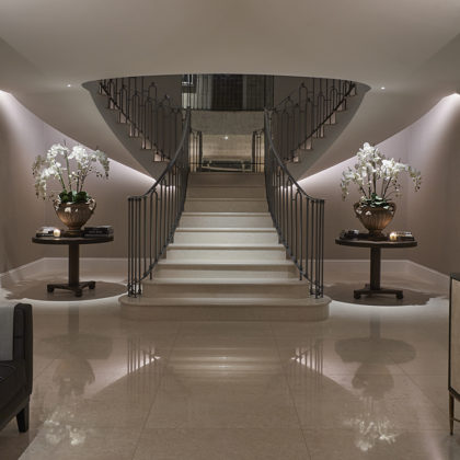 dramatic sweeping staircase underlit