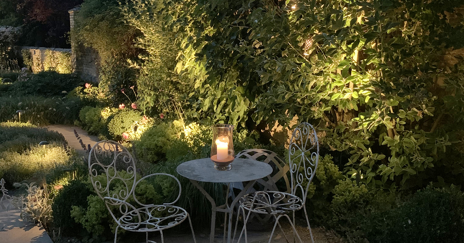 atmospheric lighting in country wall garden