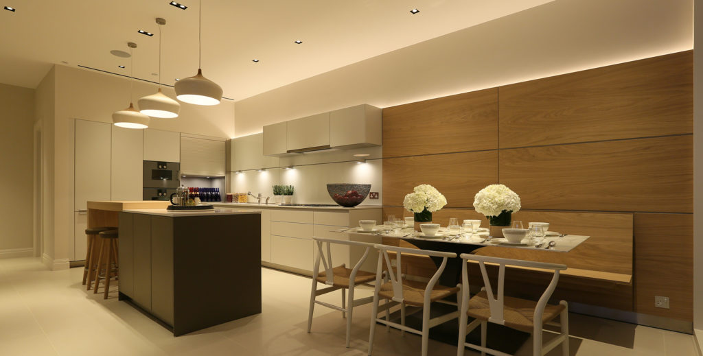 contemporary kitchen with pendants, island and banquette