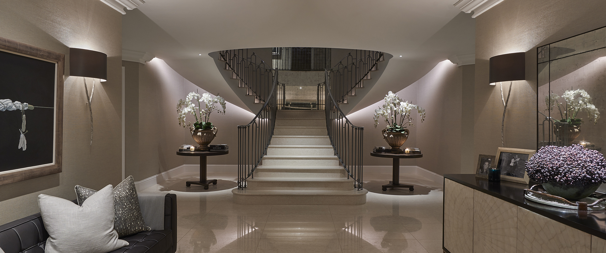 sweeping staircase underlit with linear lighting