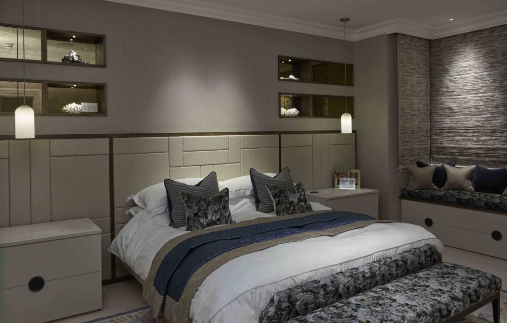 Master bedroom with niches either side of bed