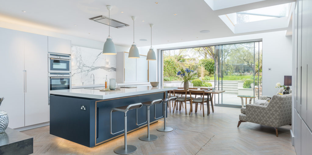 daylight floods into open plan kitchen showing natural and daylight in interior design