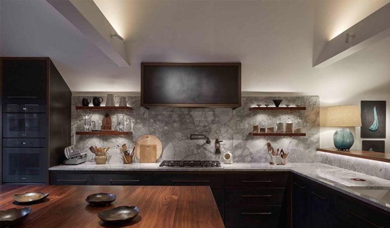 marble kitchen with back lit floating shelves