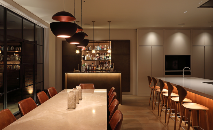 Kitchen lighting with Polespring downlights and pendant hanging lights to provide task and ambient light