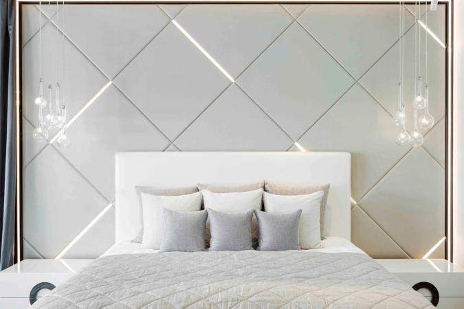 Bedroom with linear lit headboard