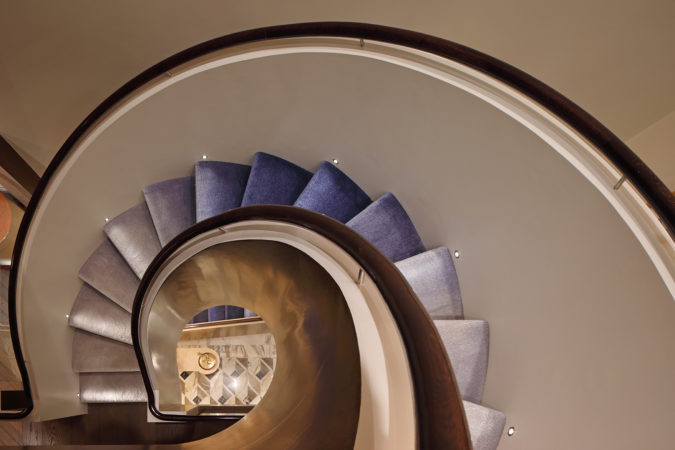 Ombre spiral staircase lit with lucca steplights