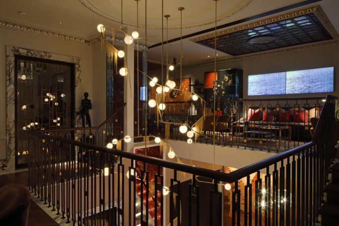 Decorative and architectural lighting combined between the floors