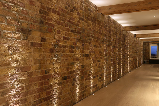 Light different textures and surfaces to highlight them including bare brick, for an industrial look