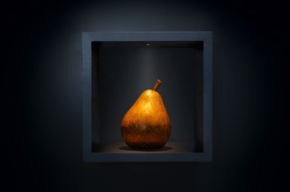 Minim joinery light lighting a pear sculpture in shelving