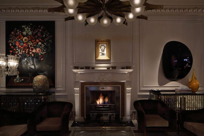 Pieces of artwork lit within a beautiful living room