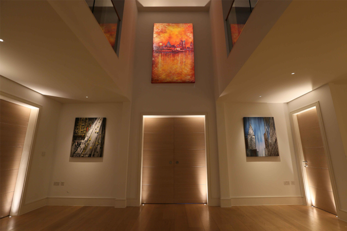three different artworks lit with carefully selected LEDS