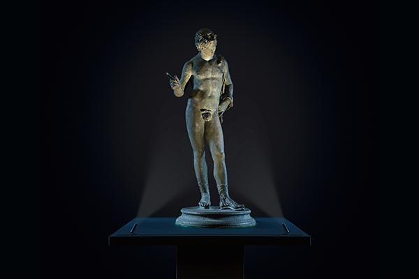 sculpture lit by vorsa dot track mounted luminaire